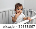 one year old child in white clothes standing in a 39653667