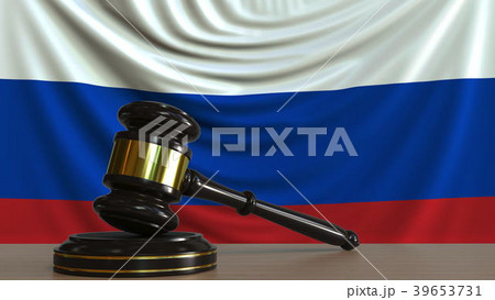 Judge's gavel and block against the flag of 39653731