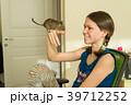 Teenage girl holding Chilean squirrel degus 39712252