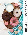 Milk and donuts on wooden table 39767568