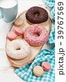 Milk and donuts on wooden table 39767569