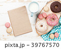 Milk and donuts on wooden table 39767570