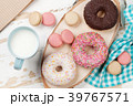 Milk and donuts on wooden table 39767571
