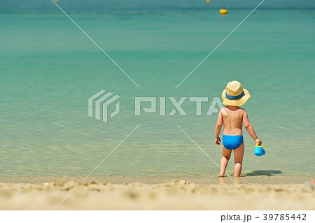 Two year old toddler playing on beach 39785442