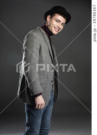 Cheerful man wearing modern suit 39786367