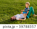 Happy woman and child having fun outdoor on meadow 39788357