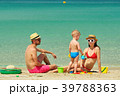 Family on beach. Toddler playing with mother and father. 39788363