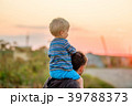 Father and son outdoor portrait in sunset sunlight 39788373