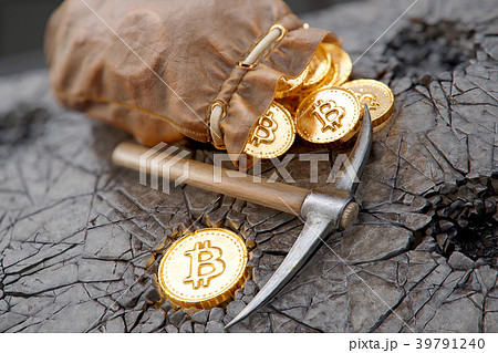 Bitcoin mining concept with pickaxe and leather 39791240