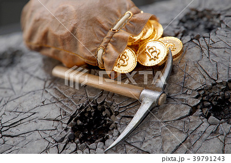 Bitcoin mining concept with pickaxe and leather 39791243