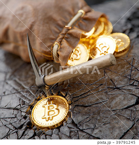 Bitcoin mining concept with pickaxe and leather 39791245