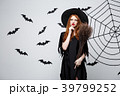 Halloween Concept - Happy elegant witch with 39799252
