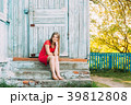 Young Caucasian Girl Sitting In Porch Of An Old 39812808