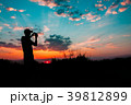 Silhouette Of Young Man Photographing Sunset On 39812899