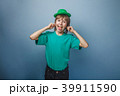 European-looking boy of ten years smiley shows the 39911590