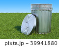 Garbage can in green grass against blue sky 39941880