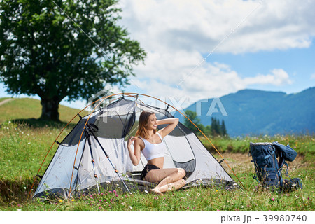 woman hiker in the camping in the mountains with backpack in the