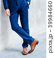 Lower part of man in formal suit posing. 39984660