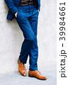 Lower part of man in formal suit posing. 39984661