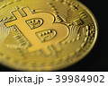 Close-up of golden bitcoin or crypto curency. 39984902