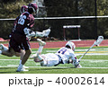 Players falling during a lacrosse game 40002614