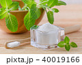 alternative natural toothpaste xylitol, soda, salt, and wood toothbrush closeup, mint on wooden 40019166