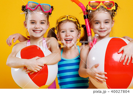 funny funny happy children in bathing suits and swimming glassesの