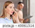 businesswoman calling on smartphone at office 40061314