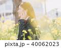 音楽 女子高生 菜の花の写真 40062023