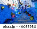 Blue street with color pots in Chefchaouen 40065938