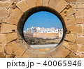 View of Essaouira through hole in wall 40065946