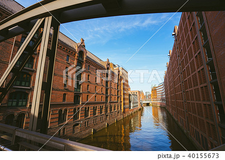 Famous landmark old Speicherstadt in Hamburg, build with red bricks. Bridge in low angle view 40155673