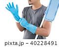 Hands on blue gloves against white background. 40228491