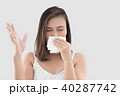 Asian woman in white dress catch her nose because of a bad smell 40287742