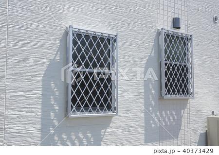 住宅 外壁 建材 面格子窓とサイディング 40373429