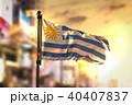 Uruguay Flag Against City Blurred Background 40407837