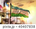 Uzbekistan Flag Against City Blurred Background 40407838