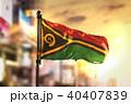 Vanuatu Flag Against City Blurred Background 40407839