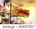 Zimbabwe Flag Against City Blurred Background 40407857