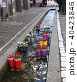 Rubber boots in the water with flowers in the city of Freiburg. Tourist attraction. 40423846