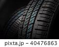 New and unused car tires against dark background 40476863