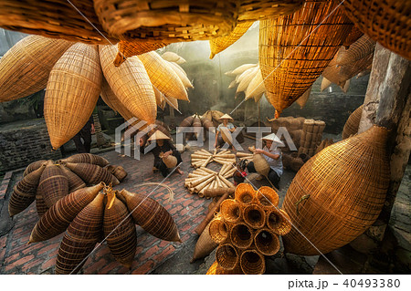 Group of Old Vietnamese female craftsman making the traditional bamboo fish trap or weave at the old traditional house in Thu sy trade village, Hung Yen, Vietnam, traditional artist concept 40493380
