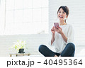 スマートフォン 若い 女性の写真 40495364