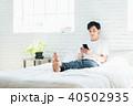スマートフォン 若い 男性の写真 40502935
