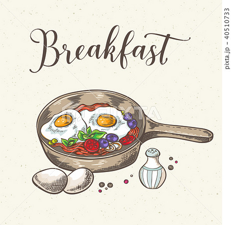 Fried eggs with bacon and tomatoes. 40510733