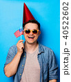 man holding an american flag 40522602