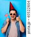 man holding an american flag 40522604