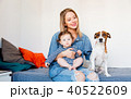 Young mother with little baby and a dog 40522609