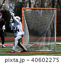 Lacrosse goalie stopping the ball 40602275