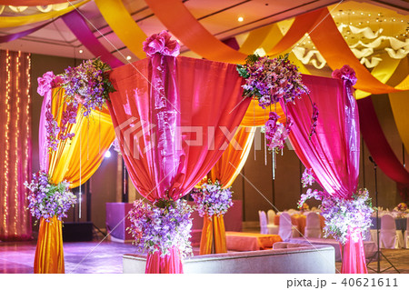 Colorful stage decoration in sangeet night party 40621611
